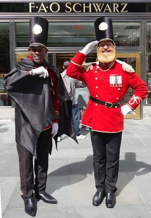 NEW YORK - SEPTEMBER 8, 2019: A doormen dressed as a toy soldier stand outside newly reopened the FAO Schwarz flagship store at Rockefeller Plaza in Midtown Manhattan 報道画像