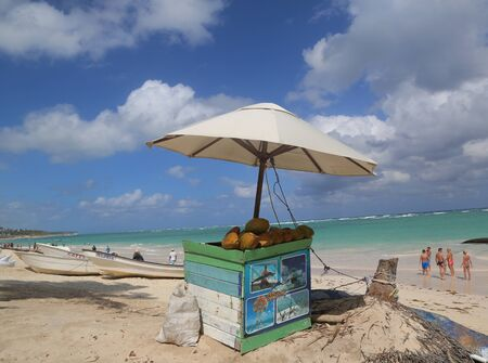 PUNTA CANA, DOMINICAN REPUBLIC - JANUARY 1, 2019: Beach stand with coconuts at Bavaro Beach in Dominican Republic Sajtókép