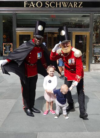 NEW YORK - SEPTEMBER 8, 2019: A doormen dressed as a toy soldier stand outside newly reopened the FAO Schwarz flagship store at Rockefeller Plaza in Midtown Manhattan 写真素材 - 134817462