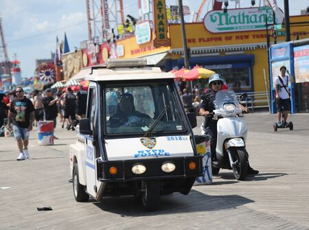 BROOKLYN, NEW YORK - AUGUST 19, 2017: The New York Police Department provides security at Coney Island Boardwalk in Brooklyn. NYPD, established in 1845, is the largest police force in USA