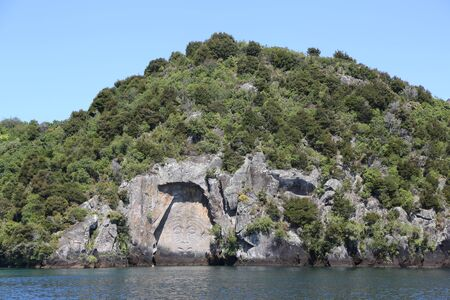The giant Mine Bay Maori rock carving of Ngatoroirangi on Lake Taupo, New Zealand. It is one of New Zealands most extraordinary contemporary Maori artworks.