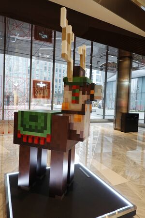 NEW YORK - DECEMBER 1, 2019: Festive Jolly Llama Minecraft Earth statue of Mobs at Hudson Yards Mall in New York