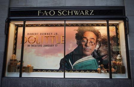 NEW YORK - DECEMBER 5, 2019: Dolittle movie advertising at the FAO Schwarz flagship store window display in Rockefeller Center in Midtown Manhattan