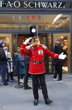 NEW YORK - DECEMBER 5, 2019: A doormen dressed as a toy soldier stand outside reopened the FAO Schwarz flagship store at Rockefeller Plaza in Midtown Manhattan 報道画像
