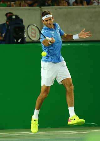 RIO DE JANEIRO, BRAZIL - AUGUST 14, 2016: Grand Slam champion Juan Martin Del Potro of Argentina in action during his men singles final match of the Rio 2016 Olympic Games at the Olympic Tennis Centre