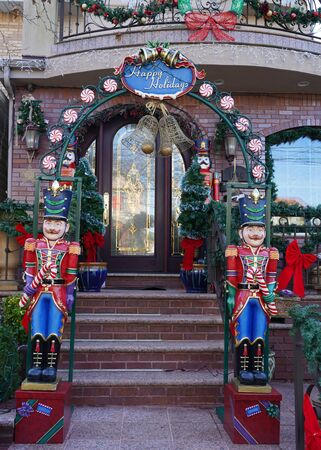 BROOKLYN, NEW YORK - DECEMBER 12, 2019: Christmas house decoration display in the suburban Brooklyn neighborhood of Dyker Heights