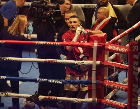 NEW YORK - DECEMBER 8, 2018: Lightweight division professional boxer Teofimo Lopez of Brooklyn, NY celebrates victory after fight against Mason Menard in Madison Square Garden in New York