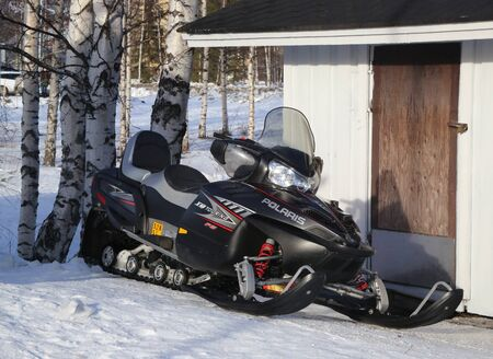 ROVANIEMI, FINLAND - FEBRUARY 19, 2017: Modern snowmobile in Rovaniemi in the Lapland region of Finland.