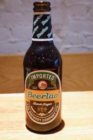 NEW YORK - DECEMBER 5, 2019: Beerlao dark lager beer bottle in New Yorks Asian restaurant Sajtókép