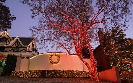 BROOKLYN, NEW YORK - DECEMBER 19, 2019: Christmas house decoration lights display in the suburban Brooklyn neighborhood of Dyker Heights
