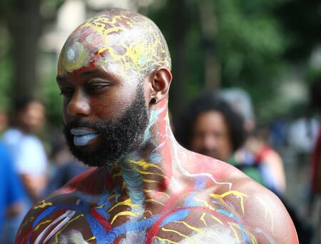 NEW YORK - JULY 22, 2017: Artists paint 100 fully nude models of all shapes and sizes during 4th NYC Body Painting Day featuring artist Andy Golub on Washington Square in New York Sajtókép