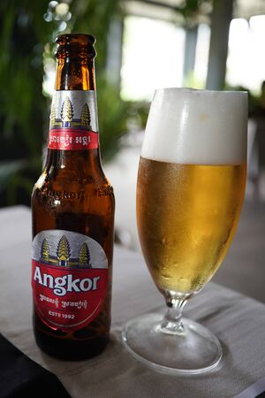 SIEM REAP, CAMBODIA - NOVEMBER 5, 2019: Angkor beer served in Cambodian restaurant in Siem Reap. Angkor Beer is a Cambodian beer, named after the iconic Khmer Angkor temples near Siem Reap Editöryel