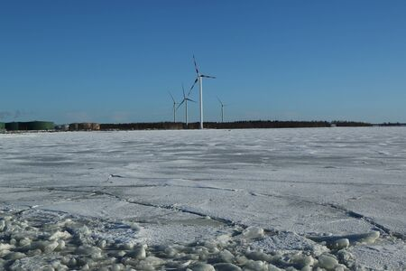Wind turbines and frozen Baltic Sea in Lapland, Finland