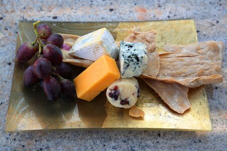 Cheese platter served with grapes