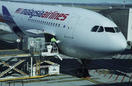 MELBOURNE, AUSTRALIA - JANUARY 31, 2016: Malaysia Airlines aircraft on tarmac at Melbourne International Airport.