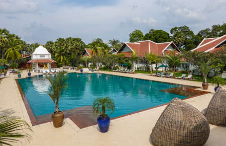 SIEM REAP, CAMBODIA - NOVEMBER 7, 2019: Pool in the historic luxury Raffles Grand Hotel d'Angkor in heart of Siem Reap, Cambodia