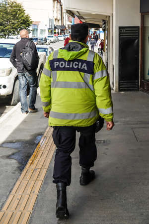 USHUAIA, ARGENTINA - FEBRUARY 5, 2020: Police Officer in Ushuaia, Argentina. Ushuaia is a resort town in Argentina located on the Tierra del Fuego archipelago, the southernmost tip of South America