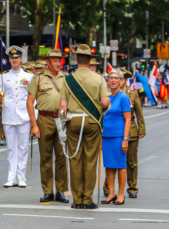 MELBOURNE, AUSTRALIA - JANUARY 26, 2019: The Governor of Victoria the Hon. Linda Dessau AC inspecting the military guard during 2019 Australia Day Parade in Melbourne 에디토리얼
