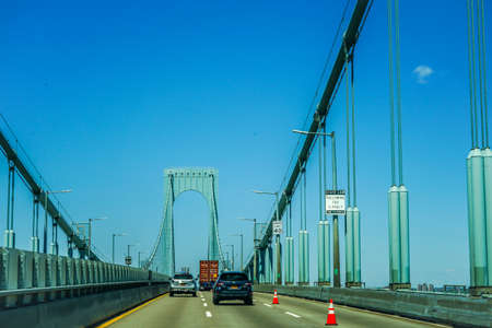 NEW YORK - MAY 12, 2020: Crossing the Whitestone Bridge in Queens. Interstate 678 crosses the East River on the Bronx Whitestone Bridge Редакционное