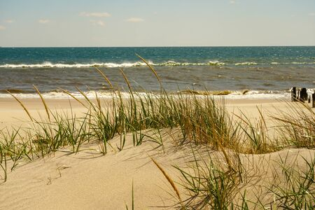 Dunes and waves at Atlantic's beach Stock Photo