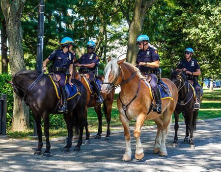 NEW YORK - SEPTEMBER 3, 2019: NYPD mounted unit police officers ready to protect public in Flushing Meadows Park in New York