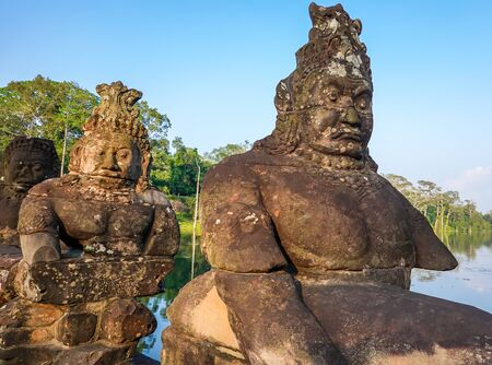 South gate bridge of Angkor Thom with statues of gods and demons Stok Fotoğraf