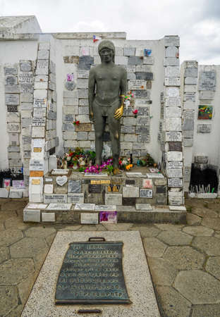 PUNTA ARENAS, CHILE - JANUARY 31, 2020: Memorial of the Indio Desconocido, a legend of cemetery, at a Cemetery of Punta Arenas Sara Braun in Chile