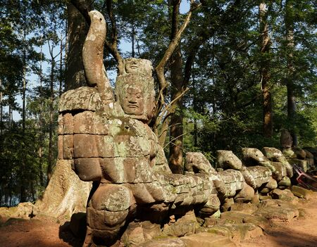 Statues of Demons and Gods near East Gate, also known as the Gate of the Dead, in Angkor What, Cambodia