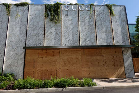 MANHASSET, NEW YORK - JUNE 7, 2020: Gucci store boards up as a precaution to prevent looting of the store in Americana Manhasset. Americana Manhasset is an upscale, open-air shopping center located in New York's suburb
