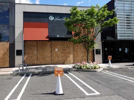 MANHASSET, NEW YORK - JUNE 7, 2020: Loro Piana store boards up as a precaution to prevent looting of the store in Americana Manhasset. Americana Manhasset is an upscale, open-air shopping center located in New York's suburb