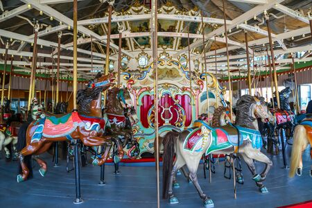 Horses on a traditional fairground B&B carousel at historic Coney Island Boardwalk in Brooklyn