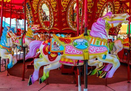 Horses on a Coney Island carousel in Luna Park at historic Coney Island Boardwalk in Brooklyn