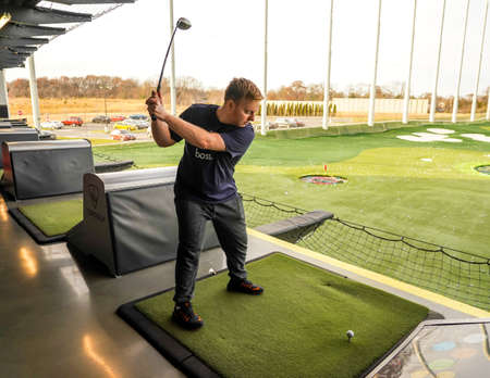 EDISON, NEW JERSEY - DECEMBER 8, 2019: Player scores points by hitting ball at Topgolf  the premier entertainment destination in Edison, NJ. Topgolf Entertainment Group is a global sports and entertainment  community Editorial