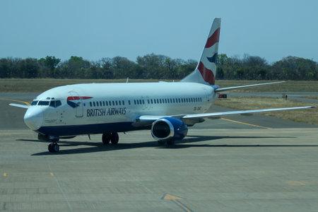 LIVINGSTONE, ZAMBIA - OCTOBER 4, 2018: British Airways plane on tarmac at Harry Mwanga Nkumbula International Airport in Zambia Sajtókép