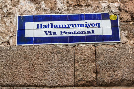 CUSCO, PERU - OCTOBER 4, 2020: Hatunrumiyoc street sign in Cusco, Peru. Hatunrumiyoc is a street in central Cusco and a well-known attraction with best-preserved Incan structures Editorial