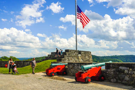 TICONDEROGA, NEW YORK - AUGUST 23, 2020: Tourists at the historic  Fort Ticonderoga in Upstate New York. Fort Ticonderoga, formerly Fort Carillon, is a large 18th-century star fort built by the French