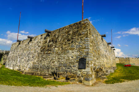 Exterior wall and cannons at the historic Fort Ticonderoga in Upstate New York. Fort Ticonderoga, formerly Fort Carillon, is a large 18th-century star fort built by the French in northern New York