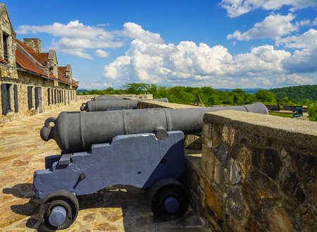 Row of cannons at the historic Fort Ticonderoga in Upstate New York. Fort Ticonderoga, formerly Fort Carillon, is a large 18th-century star fort built by the French in northern New York, United States
