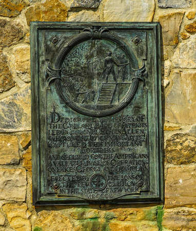 TICONDEROGA, NEW YORK - AUGUST 23, 2020: Memorial plaque at the historic Fort Ticonderoga in Upstate New York. Fort Ticonderoga, formerly Fort Carillon, is a large 18th-century star fort