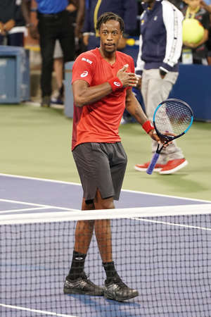 NEW YORK - AUGUST 29, 2019: Professional tennis player Gael Monfis of France celebrates victory after his 2019 US Open second round match at Billie Jean King Tennis Center 新聞圖片