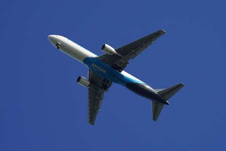 NEW YORK - SEPTEMBER 5, 2020: Amazon Air cargo plane descending for landing at JFK International Airport in New York