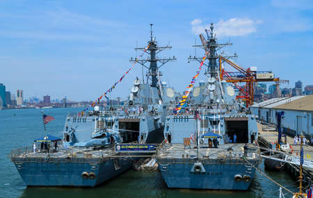 NEW YORK - MAY 26, 2016: US Navy guided-missile destroyers USS Bainbridge and USS Farragut docked in Brooklyn Cruise Terminal during Fleet Week 2016 in New York Editorial