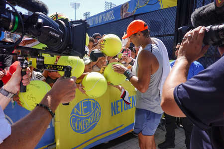 NEW YORK - SEPTEMBER 3, 2019: Grand Slam Champion Rafael Nadal of Spain signs autographs after practice for 2019 US Open at Billie Jean King National Tennis Center in New York