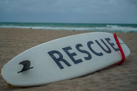 Rescue surf board at the Hollywood Beach Lifeguard Station in South Florida. The promenade along the beach lined with palm trees and resorts is a popular tourist destination in Broward County Stock fotó