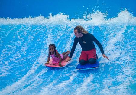HOLLYWOOD BEACH, FLORIDA - DECEMBER 30, 2020: FlowRider at Margaritaville Hollywood Beach Resort Sajtókép