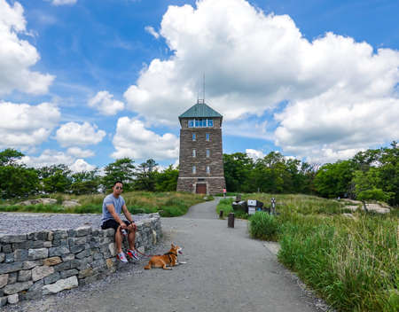 BEAR MOUNTAIN, NEW YORK - JUNE 21, 2020: Perkins Memorial Tower at the summit of Bear Mountain provides a view of four states and the skyline of Manhattan