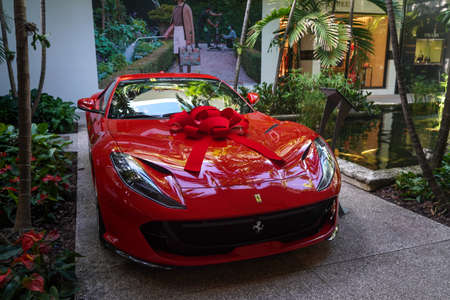 BAL HARBOUR, FLORIDA - DECEMBER 31, 2020: Ferrari 812 Superfast on display at the Bal Harbour Shops, an open-air shopping mall in Bal Harbour, a suburb of Miami, Florida