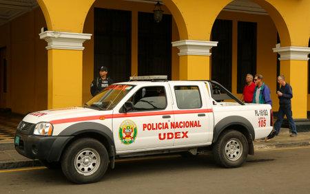 LIMA, PERU - SEPTEMBER 29, 2016: Police car provides security near Plaza de Armas in Lima, Peru Sajtókép