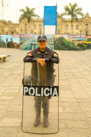 LIMA, PERU - SEPTEMBER 29, 2016: Police officer provides security near Plaza de Armas in Lima, Peru Sajtókép