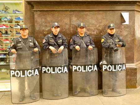 LIMA, PERU - SEPTEMBER 29, 2016: Police officers provide security near Plaza de Armas in Lima, Peru